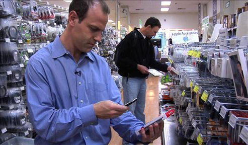 Man shopping for a mobile phone